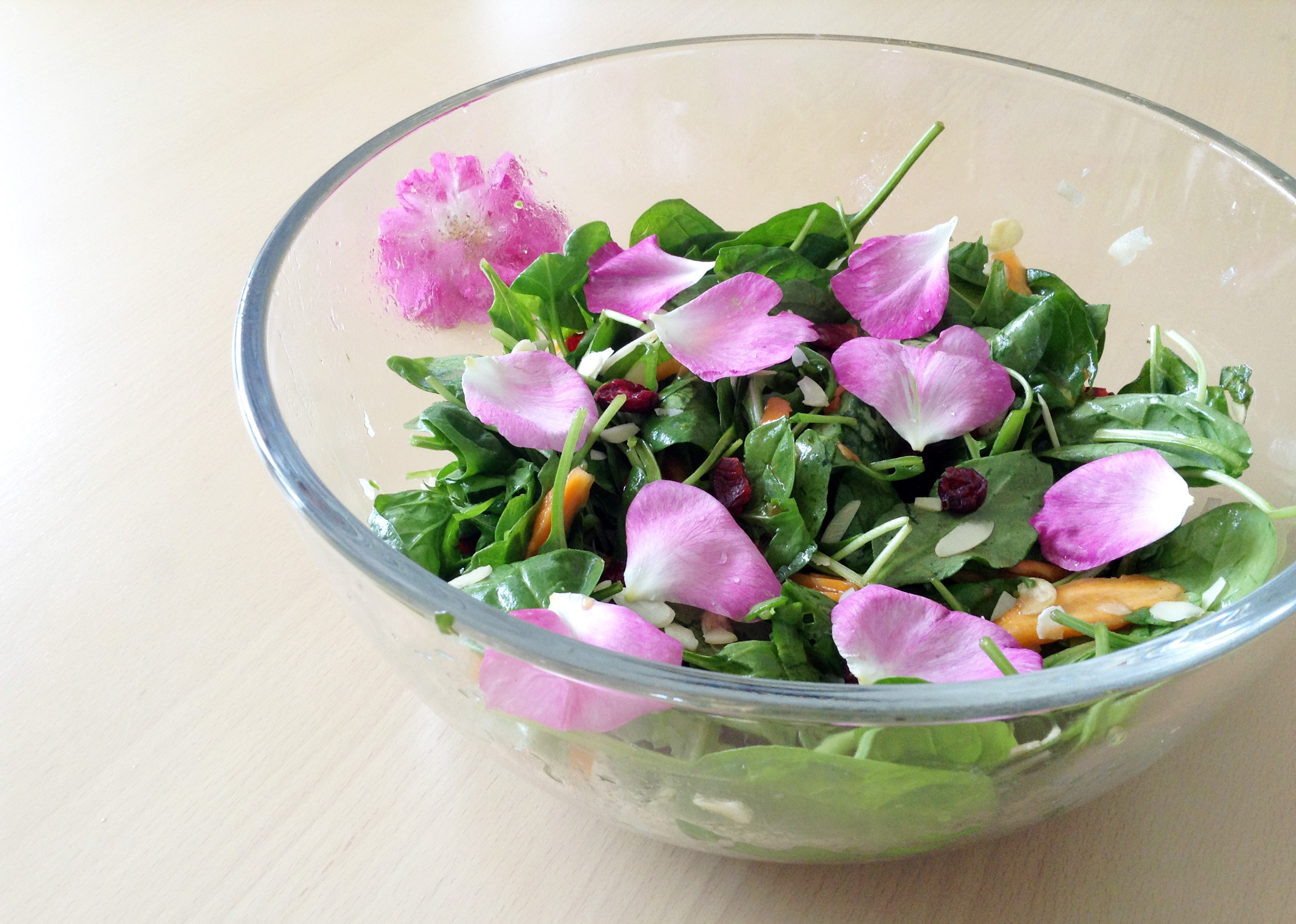 Floral salad with spinach, arugula and roses
